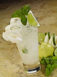 Spicy Pear Mojito 1/4 whole, fresh pear, cored, chopped 6 fresh mint leaves 3 lime wedges 1/2 oz. Monin Pineapple Chipotle Syrup 1/2 oz. simple syrup 1 1/2 oz. Grey Goose La Poire Vodka 1 oz. Perrier