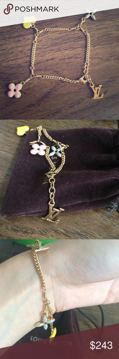 LV multicolor monogram sweet charm bracelet Brass with gold finishing. Adjustable charm bracelet with signature LV logos. Small yellow heart, pink and blue flower charms. Gently used. Comes with dust bag and original box. Louis Vuitton Jewelry Bracelets