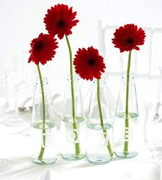 Who knew etching cream was cheap stuff that could make pretty simple glasses prettier? Etched-Glass Vase Centerpiece