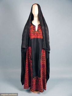 "PALESTINIAN WOMAN'S DRESS & SHAWL, EARLY 20TH C Black cotton dress w/ dense, stunning cross-stitch embroidery in red, pink, orange, yellow, white, & green, black silk damask shawl w/ embroidery similar to dress, B 44"", L 56"", shawl, 69""x72"" - Augusta Auctions"