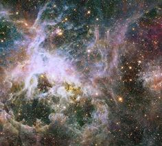Like lifting a giant veil, the near-infrared vision of NASA's Hubble Space Telescope uncovers a dazzling new view deep inside the Tarantula Nebula. Hubble reveals a glittering treasure trove of more than 800,000 stars and protostars embedded inside the nebula.