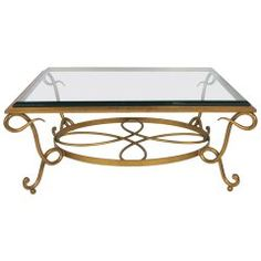 https://www.1stdibs.com/furniture/tables/coffee-tables-cocktail-tables/french-mirrored-coffee-table-style-rene-drouet-wrought-iron-base/id-f_6907273/
