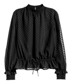 Black. Long-sleeved blouse in airy, textured, sheer woven fabric. Opening and button at back of neck, drawstring at waist, and smocking at neckline and