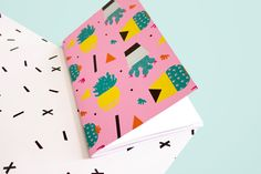 """This cactus-meets- Trapper-Keeper- confetti print makes for a 90s design  worthy of a next-millennium gift.Notebook, sketchbook, diary, journal,  whatever. Just keep it nearby—you never know when inspiration will strike.  •5 x 7.75"""" notebook. •64 blank pages. •Hand stamped interior. •Printed locally and assembled by hand in our NYC studio."""