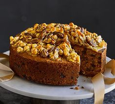 Try a modern twist on a traditional Christmas cake with this salted caramel version. Laced with chunks of toffee and dates, plus a crunchy, nutty topping, it's a real treat Chocolate Fridge Cake, Tea Loaf, Almond Brittle, Sticky Date Pudding, Spiced Pecans, Cake Tins, Convenience Food, Holiday Recipes, Cake Recipes
