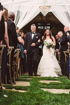 Bride and Father Walking Down the Aisle | Brides.com