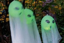 Glowing Ghosts - glow stick in balloon draped w/ cheesecloth.