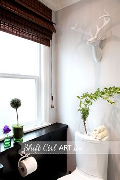 Like the wood floor counter top creation, IKEA cabinetry hack, and the modern toilet