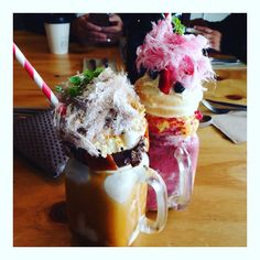 Freak Shakes Restaurant - Naughty Boy Cafe @naughtyboycafe (Princes Hill) Pavlova - Coconut milk vanilla & lime passionfruit curd meringue kiwi fruit mixed berries & strawberry fairy floss Salted Caramel - Nutella sticky date rice pudding peanut brittle butterscotch cream Rating - 10/10 #Melbourne #breakfast #freakshakes #milkshake #dessert #cafe #naughtyboycafe by laura.explora