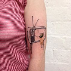 Get a tattoo of a camera, with something leaking out of the lens it like this. But have what's leaking out represent imagination somehow.... something abstract