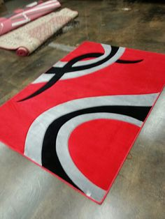 This rug is hand crafted and it is very extraordinary, with a very artistic design and it's very colors.It'll be nice fit for any room. http://rugaddiction.com/collections/hand-carved/products/unique-geometric-area-rug-with-design-in-red-hand-carvedhttp://rugaddiction.com/collections/hand-carved/products/unique-geometric-area-rug-with-design-in-red-hand-carved