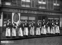 Waiters ready for their annual race, rue Rougemont. Paris (IX arr.), c1920.