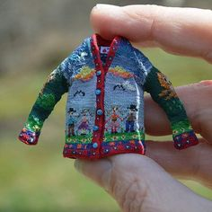 Miniature coat with lots of detail. Looks to be in 1/12 scale.