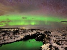 Take a look at the otherworldly greens and purples of the Aurora Borealis in Iceland!  Thingvellir National Park Iceland