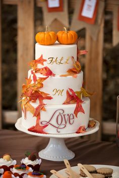 autumn wedding cake with pumpkins and maple leaves