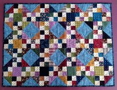 Meandering - pattern designed by Kim Diehl for the Simple Whatnots Club.  Quilt made by WashTub Quilts and quilted by Farmhouse Quilts.