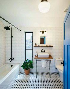 White subway tile, oil rubbed bronze hardware, minimalist designed bathroom. Perfection!