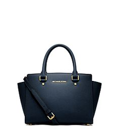 Get a handle on timeless style with our treasured Selma Saffiano leather satchel. Offering up a smart, structured shape and subtle logo detailing, it strikes a high-fashion chord, while promising a smart sensibility season after season. Carry it at the crook of the arm for a major statement, or across the chest as a carefree crossbody.