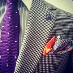 Purple Tie, Colorful pocket square and tiny rose pin on lapel buttonhole.  Checks on Striped Shirt, white collar.  It all balances nicely.