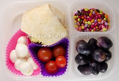 """""""Today D has a little of her BBQ chicken wrap left over from dinner last night, some cherry tomatoes, fresh mozzarella, black grapes and some chocolate covered sunflower seeds."""""""