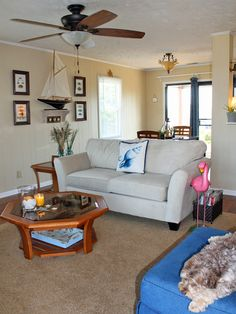 Open, bright and sunny beach house living room after makeover