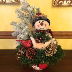 A personal favorite from my Etsy shop https://www.etsy.com/listing/259919938/free-shipping-snowman-arrangement-winter