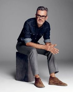 The GQ Guide To Business Casual Suit pants, $195. Denim shirt, $98. Boots, $135. All by J.Crew.