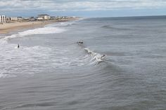 View from Jennette's Pier in Nags Head, NC overlooking surfers catchings some waves
