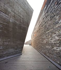 Admire the volumetry of the Ningbo Historic Museum by Amateur Architecture Studio. (Photo by Clément Guillaume)  http://www.archdaily.com/14623/ningbo-historic-museum-wang-shu-architect/