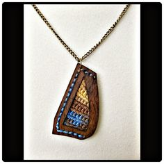 Modern Mixed Media pendant combining Rosewood with crochet.