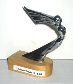 Triumph Car Mascot - Gloria 1934/36, 4 and 6 cylinder models.  Winged Goddess.  This one has a flat base.  I have seen others with a curved base.  Sometimes fitted direct to the radiator cap.