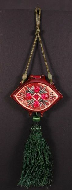 BAKELITE COMPACT WITH ROSES : Lot 47  Unusual green cord and tassel with this red celluloid dance purse---it's probably not Bakelite