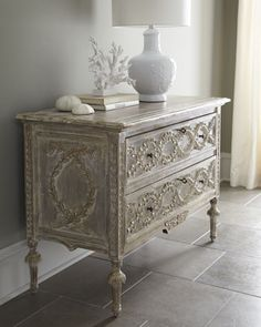 Cassie Chest from Horchow:   Ornate Louis XVI-style chest features detailed, hand-carved interlaced laurel motifs.