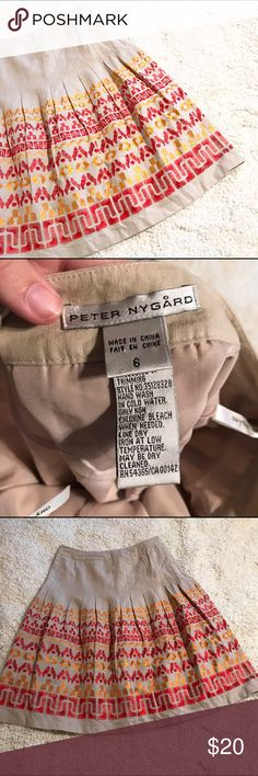 Peter Nygard Embroidered Khaki Skirt This is an Embroidered skirt by Peter Nygard in size 6. EUC. Measures about 24 inches in length and 14 inches across at the waist. Feel free to ask any questions. Peter Nygard Skirts Midi