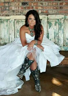 cowboy boots and wedding dress..this is deff the attire for my wedding