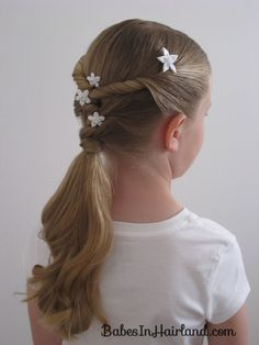 Twists & Knots Hairstyle--cute! Have to wait for Abby's hair to grow out a bit though.