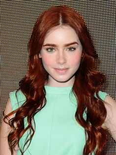 Lily collins with red hair, green eyes and freckles! Perfect Clary! I wish it was done like this for the movie