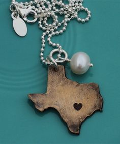 great for all those texas girls out there.  this company also has some awesome jewelry and even some that you can customize.  this one lets you put the heart over whatever city you want.