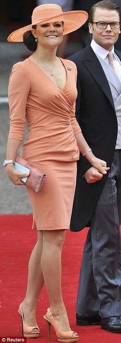 Sweden's Crown Princess Victoria, arriving with husband Prince Daniel, also went for the colour-blocking trend in an orange Elie Saab wrap dress with matching shoes and a wide-brimmed hat