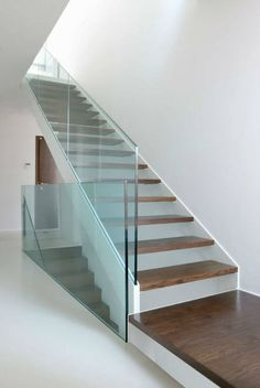 Photo about Wooden stairs with glass balustrade in modern interior and white epoxy flooring. Image of stairs, entrance, light - 46303342 Attic Renovation, Attic Remodel, Floating Staircase, Attic Staircase, Attic Ladder, Staircases, Staircase Handrail, Attic Loft, Stair Railing