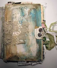 Use an old book cover and scraps of fabric. Creative! a memory book maybe? Old letters and postcards!