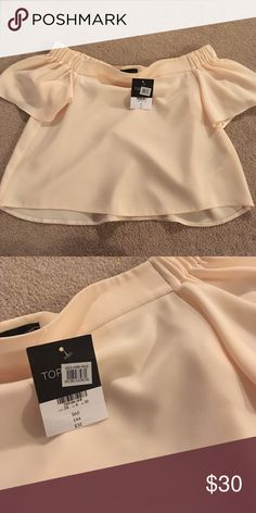 Nwt Topshop Off the Shoulder Top Size 6 NWT.  Stock photo is the same shirt, but a different color. Topshop Tops Blouses