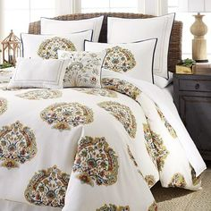 "<i>Taj</i> means ""crown"" in Aramaic, and our Taj Paisley bedding will give you a royal welcome each night. The duvet cover and shams are made of crisp cotton and have a colorful block-like print that suggests a crown motif made of florals and paisleys. They're accented with embroidered, flanged and pompom-trimmed decorative pillows and Euro sham. Enjoy your night, your highness."