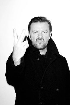 Ricky Gervais/He Is not giving a peace sign..