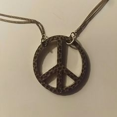 Silver lucky Brand peace sign necklace Hammered look on peace sign. I also have a gold one that I hang from my rear view mirror. Lucky Brand Jewelry Necklaces