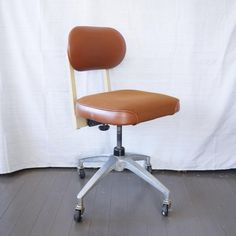 "A beautiful vintage industrial desk chair by Cosco in the 1970's. A great chair for your ""work from home"" office!This chair has the original caramel brown vinyl back rest and tweed seat fabric. The swivel base is polished aluminum. The chair height is adjustable.There is some minor scratching on the back of the chair frame. The upholstery is in wonderful condition as shown in the photos. Industrial Desk, Vintage Industrial, Vintage Desk Chair, Chair Height, Caramel Brown, Vintage Home Decor, Rustic Style, Home Office, Tweed"