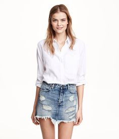 Distressed denim mini skirt with pockets & raw-edge hem. | H&M Denim
