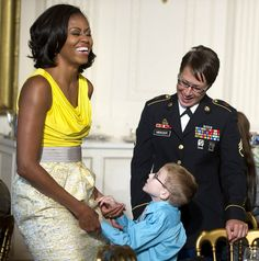 Love the mix of color-blocking and jacquard in the Rachel Roy dress Mrs. O so vibrantly wore during a reception for military children and their families at the White House.