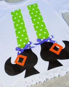 Make these cute DIY Halloween shirts for girls with cute little witch legs and shoes. Easy to make and a fun Halloween shirt for your child to wear.