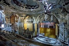 The ruined Spanish-Gothic interior of the United Artists Theater in Detroit.  Photograph: Yves Marchand and Romain Meffre
